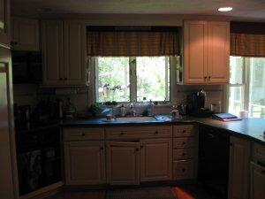 Before photo of dark kitchen